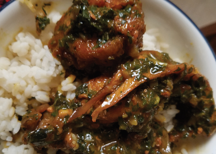 Okra with fish and chicken over rice