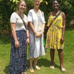 Lorvena, on the right of Monika, is a nurse. Madi, on the left, is a school teacher.